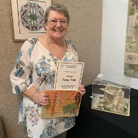 Congratulations to Geelong Member, Robyne Undy, whose piece 'Home Sweet Home' received the most votes from visitors to the recent Stitch Brilliance exhibition. See our Facebook page and Threadlines for more images of Robyn's embroidery prowess.